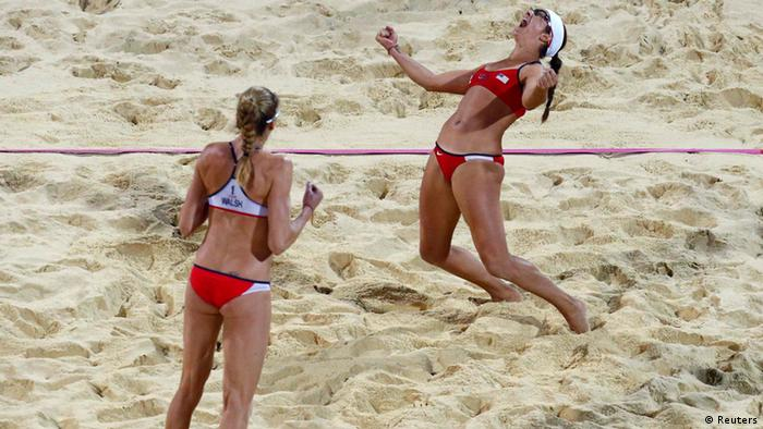 Misty May-Treanor of the U.S. and team mate Kerri Walsh Jennings (L) celebrate winning the women's beach volleyball gold medal match at the Horse Guards Parade during the London 2012 Olympic Games August 8, 2012. REUTERS/Dominic Ebenbichler (BRITAIN - Tags: SPORT OLYMPICS SPORT VOLLEYBALL)