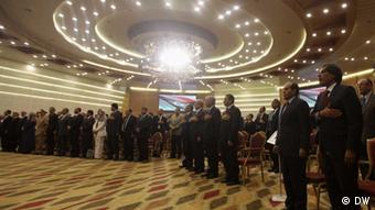 Participants stand during the handover ceremony of power from of the National Transitional Council (NTC) to members of the national congress in Tripoli, August 8, 2012. Libya's ruling council handed over power to a newly elected national assembly on Wednesday in the North African country's first peaceful transition of power in its modern history but which comes amid heightened violence. REUTERS/Esam Al-Fetori