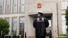 Source News Feed: EMEA Picture Service ,Germany Picture Service Police officers stand outside the Hefei Intermediate People's Court, where Gu Kailai is being tried for murder, in Hefei, Anhui Province August 9, 2012. China holds its most sensational trial this week since convicting the Gang of Four over 30 years ago, putting Gu Kailai, the wife of deposed leader Bo Xilai, in the dock for murder. REUTER/Aly Song (CHINA - Tags: CRIME LAW POLITICS) Date sent: 09/08/12 03:27:43