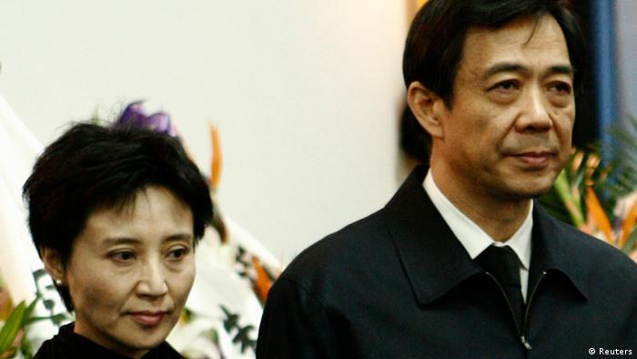 China's former Chongqing Municipality Communist Party Secretary Bo Xilai (R) and his wife Gu Kailai stand at a mourning held for his father Bo Yibo, former vice-chairman of the Central Advisory Commission of the Communist Party of China, in Beijing in this January 17, 2007 file photo. China holds its most sensational trial this week since convicting the Gang of Four over 30 years ago, putting Gu Kailai, the wife of deposed leader Bo Xilai, in the dock for murder. Legal experts and activists expect her to receive the kind of rapid guilty verdict handed down in almost all Chinese criminal trials - the kind Gu once compared favourably to the United States where she felt the guilty risked going free on legal technicalities. Picture taken January 17, 2007. REUTERS/Stringer/Files (CHINA - Tags: CRIME LAW POLITICS) CHINA OUT. NO COMMERCIAL OR EDITORIAL SALES IN CHINA