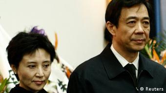 China's former Chongqing Municipality Communist Party Secretary Bo Xilai (R) and his wife Gu Kailai
