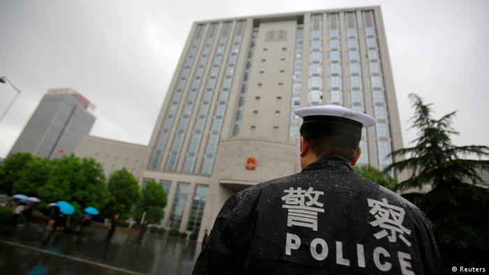 A police officer stands guard at the Hefei City Intermediate People's Court where the murder trial of Gu Kailai, wife of ousted Chinese politician Bo Xilai, takes place Thursday, Aug. 9, 2012 in Hefei, Anhui Province, China. Gu stood trial Thursday for the murder of a British former associate in a tightly orchestrated proceeding that marks a key step to resolving the messiest scandal the leadership has faced in two decades. (AP Photo/Eugene Hoshiko)
