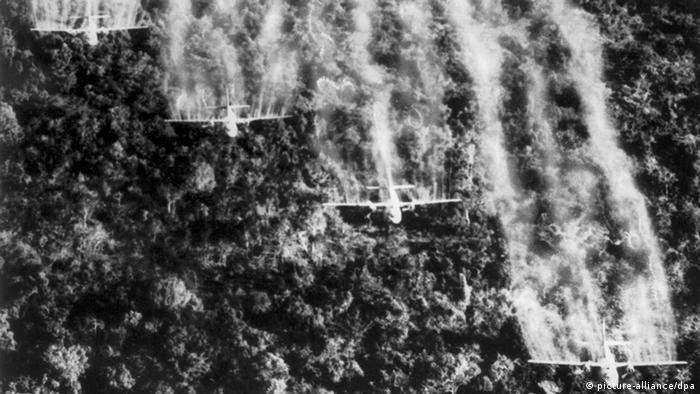Four US planes spray Agent Orange on Vietnamese jungle