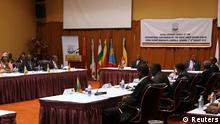 Uganda's President Yoweri Museveni (back C) chairs the International Conference on the Great Lakes Region (ICGLR) at the Commonwealth Resort Hotel Munyonyo in the capital of Kampala August 7, 2012. U.S. Secretary of State Hillary Clinton urged Rwanda and Great Lakes neighbours on Tuesday to stop supporting Congolese rebels as regional leaders met in Uganda to discuss ways to end the insurgency in the eastern Democratic Republic of Congo. REUTERS/Edward Echwalu (UGANDA - Tags: POLITICS)