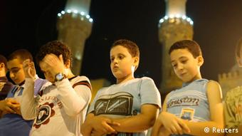 Children participate in evening prayers at a mosque in Cairo