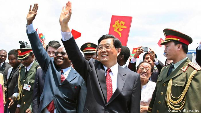 Former Chinese President Hu Jintao, with Mozambique's Armando Guebuza, are greeted in Maputo in 2007