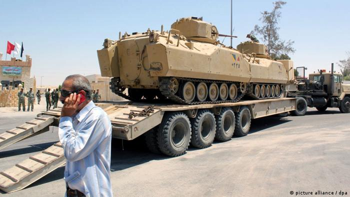 Egyptian army tanks loaded on trucks are seen ahead of expected offensive against militants, in Arish, northern Sinai, 09 August 2012.