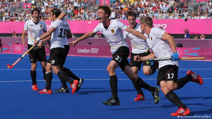 Germany's Florian Fuchs (C) celebrates a goal with his teammates during the Men's field hockey semifinal Australia vs. Germany in the London 2012 Olympic Games Hockey tournament in the Riverside Arena in London, Great Britain, 09 August 2012.
