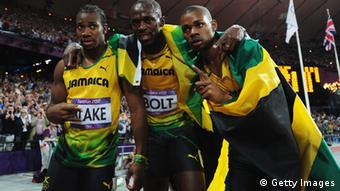 LONDON, ENGLAND - AUGUST 09: Gold medalist Usain Bolt (C) of Jamaica celebrates with silver medalist Yohan Blake (L) of Jamaica and bronze medalist Warren Weir (R) of Jamaica after the Men's 200m Final on Day 13 of the London 2012 Olympic Games at Olympic Stadium on August 9, 2012 in London, England. (Photo by Stu Forster/Getty Images)