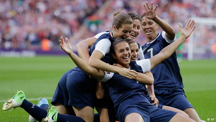United States' Carli Lloyd, right, celebrates with teammates after scoring during the women's soccer gold medal match against Japan at the 2012 Summer Olympics, Thursday, Aug. 9, 2012, in London.