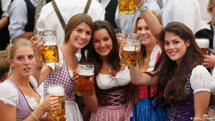Young women wearing traditional Bavarian Dirndl dresses cheer with beer mugs after the official opening of the 177th edition of the Oktoberfest beer festival in a tent at the Theresienwiese in Munich, southern Germany, on September 18, 2010. The world's biggest beer festival Oktoberfest, celebrating the 200th birthday since its creation, runs until October 4, 2010. AFP PHOTO / SEBASTIAN WIDMANN (Photo credit should read SEBASTIAN WIDMANN/AFP/Getty Images)