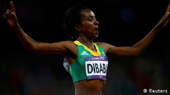 Ethiopia's Tirunesh Dibaba celebrates after winning the women's 10,000m finals at the London 2012 Olympic Games at the Olympic Stadium August 3, 2012. REUTERS/Eddie Keogh (BRITAIN - Tags: OLYMPICS SPORT ATHLETICS)
