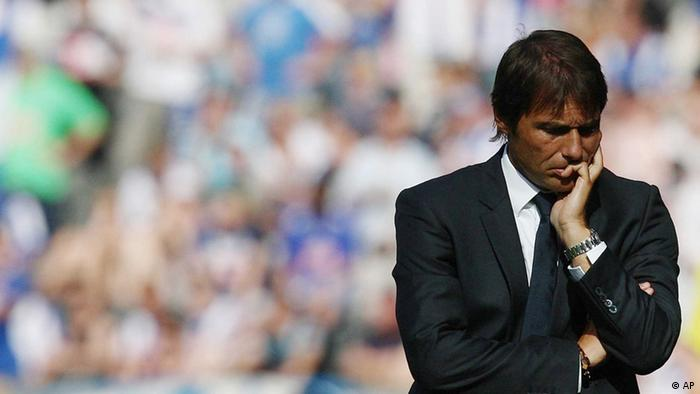 In this picture taken Saturday, July 28, 2012, Juventus coach Antonio Conte walks on the pitch during a friendly soccer match between Hertha BSC Berlin and Juventus in Berlin, Germany.