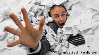 Businessman sinking in heap of documents © Nomad_Soul #35103278