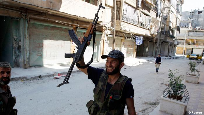 A Free Syrian Army fighter holds up his rifle in the Salaheddine neighbourhood of central Aleppo August 10, 2012. REUTERS/Goran Tomasevic (SYRIA - Tags: CIVIL UNREST)