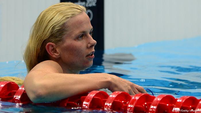 Germany's Britta Steffen reacts after she competed in the women's 50m freestyle final during the swimming event at the London 2012 Olympic Games on August 4, 2012 in London. AFP PHOTO / MARTIN BUREAU (Photo credit should read MARTIN BUREAU/AFP/GettyImages)