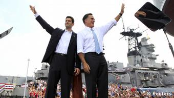 Republican U.S. presidential candidate Mitt Romney and U.S. Congressman Paul Ryan (R-WI) wave after Romney introduced Ryan as his vice-presidential running mate during a campaign event at the battleship USS Wisconsin in Norfolk, Virginia´ REUTERS/Shannon Stapleton