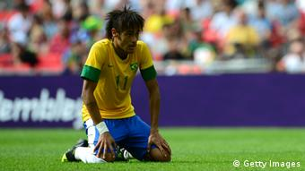 Brazil's forward Neymar looks dejected after Mexico won the men's football final match between Brazil and Mexico at Wembley stadium in London during the London Olympic Games on August 11, 2012. (Photo via AFP)
