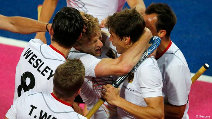 Germany's Jan Philipp Rabente with team mates celebrates scoring a goal