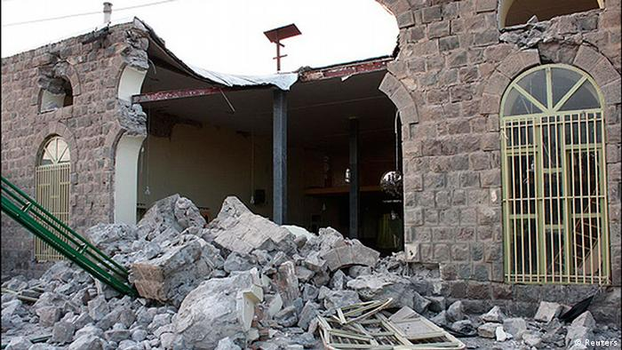 A damaged building is seen in this undated handout photo taken in an undisclosed location in northwest Iran. Two powerful earthquakes killed 250 people and injured around 1,800 in northwest Iran, where rescue workers frantically combed the rubble of dozens of villages throughout the night and into Sunday as medical staff desperately tried to save lives. REUTERS/Hamed Nazari/Mehr News Agency (IRAN - Tags: DISASTER) FOR EDITORIAL USE ONLY. NOT FOR SALE FOR MARKETING OR ADVERTISING CAMPAIGNS. THIS IMAGE HAS BEEN SUPPLIED BY A THIRD PARTY. IT IS DISTRIBUTED, EXACTLY AS RECEIVED BY REUTERS, AS A SERVICE TO CLIENTS