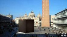 In this enhanced photo made available by German artist Gregor Schneider, a large black cube is seen in St. Mark's Square in Venice, northern Italy. The 15-meter-high (50-foot) cube made of metal scaffolding and covered by black fabric that closely resembled the Kaaba, the Muslim holy shrine in Mecca, was barred from being exhibited in St. Mark's Square as part of the Venice Biennale art festival by authorities, fearing Muslims would consider the work offensive and make the city a target for Islamic terrorists, Biennale officials said Monday. (AP Photo/Gregor Schneider)
