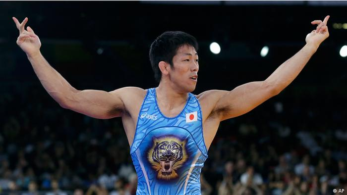 Tatsuhiro Yonemitsu of Japan celebrates after defeating Sushil Kumar of India in the 66-kg freestyle wrestling gold medal match at the 2012 Summer Olympics (Photo:Paul Sancya/AP/dapd)