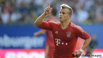 Bayern Munich's Swiss midfielder Xherdan Shaqiri celebrates scoring during the second semi-final football match Liga-Total-Cup FC Bayern Munich vs SV Werder Bremen in Hamburg, northern Germany, on August 4, 2012. AFP PHOTO/CHRISTOF STACHE (Photo credit should read CHRISTOF STACHE/AFP/GettyImages)
