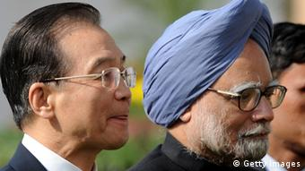 Chinese Prime Minister Wen Jiabao (L) and Indian Prime Minister Manmohan Singh (R) arrives for a series of agreement signings in New Delhi on December 16, 2010. Chinese Premier Wen Jiabao arrived in India at the head of a huge business delegation to try and shore up a relationship undermined by persistent trade and territorial disputes. AFP PHOTO/Prakash SINGh (Photo credit should read PRAKASH SINGH/AFP/Getty Images)