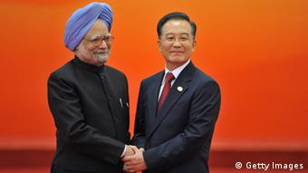 Chinese Prime minister Wen Jiabao (R) welcomes Indian Prime Minister Manmohan Singh (L) (ERIC FEFERBERG/AFP/Getty Images)
