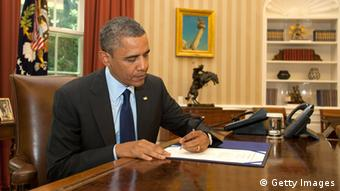 WASHINGTON, DC - JUNE 13: (AFP OUT) U.S. President Barack Obama signs S.3261, Contract Awards for Large Air Tankers, in the Oval Office of the White House June 13, 2012 in Washington, DC. The bill will support America's ability to fight wildfires by enabling the Forest Service to accelerate the contracting of the next generation of air tankers for wildfire suppression. (Photo by Martin H. Simon-Pool/Getty Images)