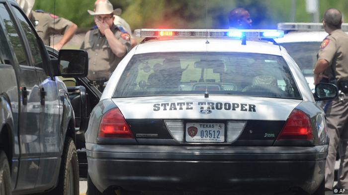 Law enforcement officers gather at the site of a shooting near Texas A&M University