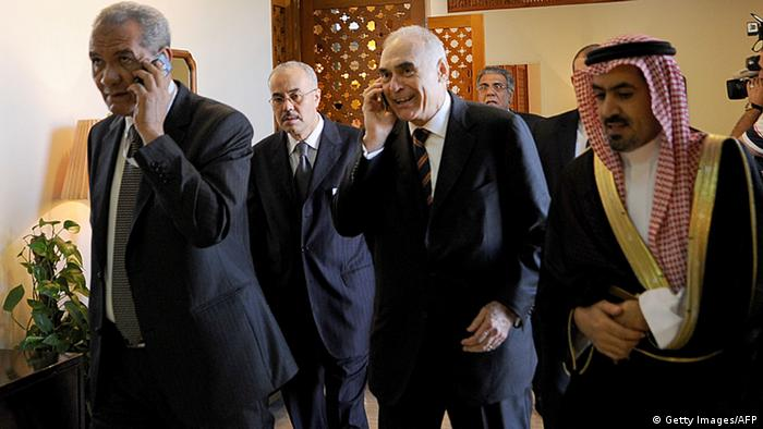 Egyptian Foreign Minister Mohammed Kamel Amr (C) talks on his phone upon his arrival to attend a preparation meeting of foreign ministers of the Organisation of Islamic Cooperation (OIC) in the Saudi coastal city of Jeddah on August 13, 2012. Leaders of Muslim countries, including Iran's pro-Syrian President Mahmoud Ahmadinejad, are due to gather for an extraordinary summit called by Saudi King Abdullah who is pushing to mobilise support for the Syrian rebellion. AFP PHOTO/FAYEZ NURELDINE (Photo credit should read FAYEZ NURELDINE/AFP/GettyImages)