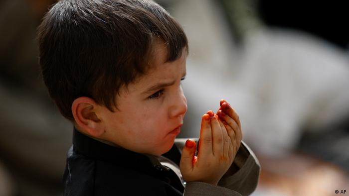 An Afghan boy offers prayers during Eid al-Fitr that marks the end of the holy fasting month of Ramadan in Kabul, Afghanistan, Tuesday, Aug. 30, 2011. (AP Photo/Rafiq Maqbool)