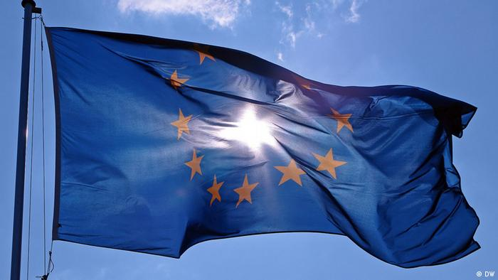 EU flag with blue sky as backdrop