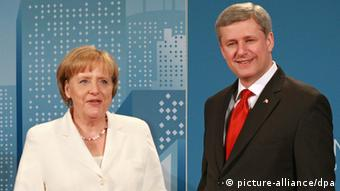 A handout photograph released by G8 G20 Host Photo showing Canadian Prime Minister Stephen Harper (R) welcoming German Chancellor Angela Merkel at The Fairmont Royal York Hotel during the G20 Summit Toronto, Ontario, Canada, on 26 June 2010. World leaders gathered for three days of talks to deal with the aftermath of the global financial crisis. EPA/DAVE CHIDLEY / G8 G20 HOST PHOTO / HANDOUT EDITORIAL USE ONLY / NO SALES