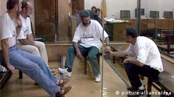 Four ETA convicts sitting behind a glass divider at the National Audience Court in Madrid