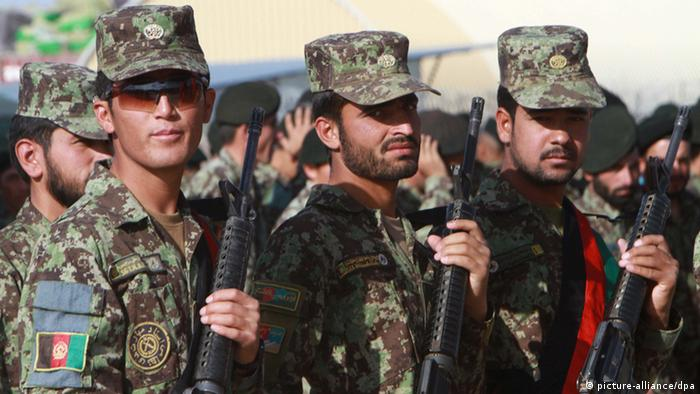 Afghan National Army soldiers perform during their graduation ceremony in Herat, Afghanistan, 09 August 2012.