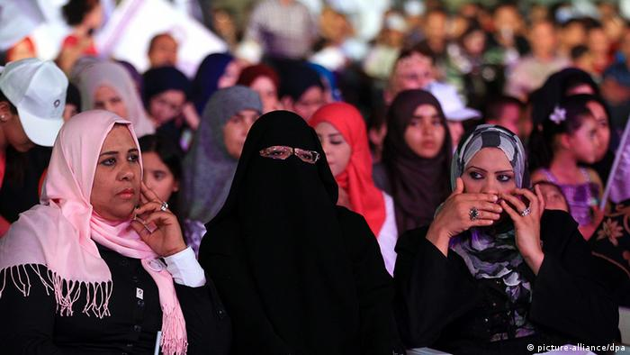 epa03295824 Libyan women, supporters of the Islamist Party al-Watan attend an election rally in Tripoli, Libya, 04 July 2012. Members of the Islamist Party al-Watan vowed on 04 July evening to commit to Islamic shariah law if they are elected in the upcoming Libyan vote. Some 2.7 million voters will head to the polls on 07 July to elect a National Congress, which will draw up a new constitution and form a government. Al-Watan party, has fielded 59 candidates for the coming elections. It is one of the major parties competing for seats in the 200-member assembly. The party cites Islam as a frame of reference in all spheres of life. Belhaj is the former emir of the now defunct Libyan Islamic Fighting Group (LIFG) and is considered de facto chief of the party. EPA/AMEL PAIN