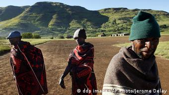 Lesotho men draped in blankets, line up as the polls open in the village of Machache, 25 miles east of the Capital Maseru Saturday, Feb. 17, 2007. Voters in the tiny southern African mountain kingdom of Lesotho go to the polls Saturday to elect a new government after 10 years of rule by the Lesotho Congress for Democracy. The election promises to be a close race between the ruling LCD, led by Prime Minister Pakalitha Mosisili, and the 4-month-old All Basotho Convention led by Tom Thabane, the former minister of communications, science and technology