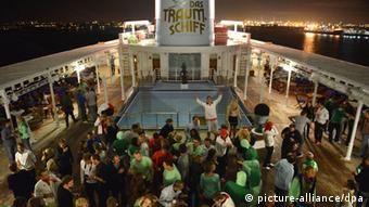 A nighttime deck scene on board the MS Deutschland.