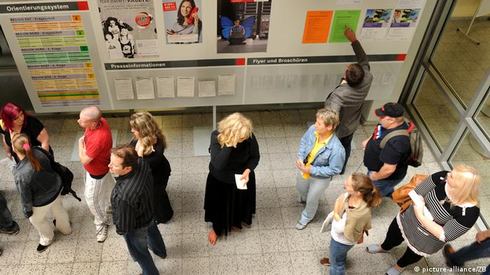 People in a line at an regional German employment office