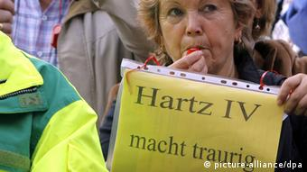A demonstrator protests against the cuts associated with Hartz IV