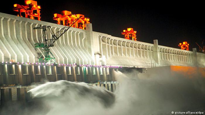 Water roars through the gates of the Three Gorges Dam on China's Yangtze River