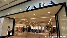 TO GO WITH AFP STORY BY JEAN LIOU A shopper exits the newly opened store of Spanish clothing retailer Zara in Johannesburg on January 18, 2012. Zara opened its first South African store in Johannesburg, as the Spanish retail chain hopes to target the country's increasingly diverse middle classes. AFP PHOTO/ALEXANDER JOE (Photo credit should read ALEXANDER JOE/AFP/Getty Images)