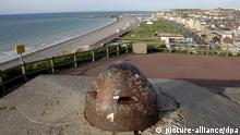 The observation cuppola of a World War II German bunker emerges on top of the Western cliff over Dieppe's beach, France, 17 August 2007, 2 days away from the 65th anniversary of the Dieppe raid in which more than 6000 allied troops, mostly Canadians, landed on 19 August 1942. At the end of the day, after a fierce land, air and sea battle, the Allies had suffered 1550 dead and some 2400 prisoners. 948 Commonwealth servicemen of the Second World War are now buried or commemorated at this cemetery EPA/HORACIO VILLALOBOS +++(c) dpa - Report+++