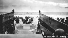 epa03337299 US Coast Guard Photo titled 'The Jaws of Death' shows a Coast Guard-manned LCVP from the U.S.S. Samuel Chase disembarking troops of Company E, 16th Infantry, 1st Infantry Division on the morning of 06 June 1944 at Omaha Beach, Normandy, France. The president of Lower Normandy region, Laurent Beauvais, has started a move for the D-Day beaches where Allied troops landed on 06 June 1944 to launch the invasion of German-occupied Europe to be listed among UNESCO's world heritage sites. The bid was backed by French President Francois Hollande during a visit to the Caen Memorial in Normandy on 06 June. 'I bring all the state support to the initiative taken by the Lower Normandy region for the registration sites landing in World Heritage of Humanity' by Unesco, he had said. The initiative, that local authorities would like to be successful for the 70th anniversary of 'Overlord' may come to nought, for UNESCO is normally reluctant to confer such distinction to battlefields. HANDOUT EDITORIAL USE ONLY