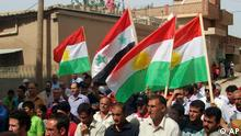 In this citizen journalism image made on a mobile phone and provided by Shaam News Network, anti-Syrian President Bashar Assad Kurds-Syrian protesters, wave their Kurdish and Syrian flag at centre as they march during a demonstration against the Syrian regime, at the Kurds-Syrian village of Amouda, in Kamishli province, Syria, on Friday, Sept. 30, 2011. Syrian security forces opened fire on protesters Friday as thousands rallied across the country to call for the downfall of President Bashar Assad's regime, activists said. (Foto:Shaam News Network/AP/dapd) EDITORIAL USE ONLY, NO SALES, THE ASSOCIATED PRESS IS UNABLE TO INDEPENDENTLY VERIFY THE AUTHENTICITY, CONTENT, LOCATION OR DATE OF THIS HANDOUT PHOTO