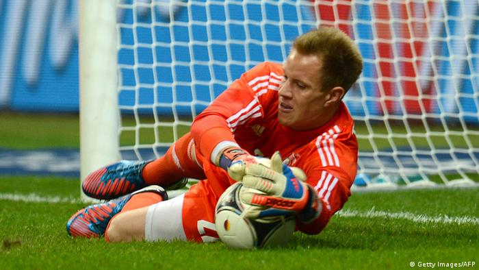 Germany`s goalkeeper Marc Ter Stegen holds the ball after a Lionel Messi penalty during the friendly football match Germany vs Argentina on August 15, 2012 in Frankfurt am Main, western Germany.