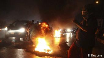 Relatives of the 11 Lebanese Shi'ite pilgrims that were abducted in Syria burn tires and block the main road leading to Beirut airport