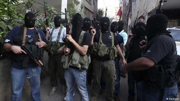 Source News Feed: EMEA Picture Service ,Germany Picture Service Shi'ite masked gunmen from the Meqdad clan, gather at the Meqdad family's association headquarters in the southern suburbs in Beirut, August 15, 2012. A Shi'ite Muslim clan in Lebanon has abducted a Turkish businessman and several Syrians it says are rebel fighters in retaliation for the kidnapping of one of their relatives by the rebel Free Syrian Army in Damascus. REUTERS/Khalil Hassan (LEBANON - Tags: POLITICS CIVIL UNREST) // eingestellt von se